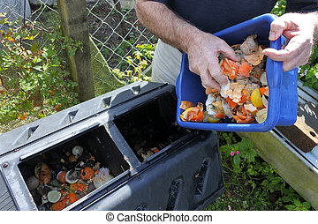 Hands emptying a container full of domestic food waste