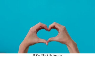 Hands folded in the shape of a heart