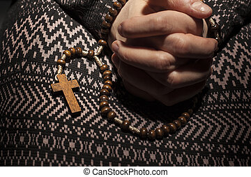 Hands folded to pray