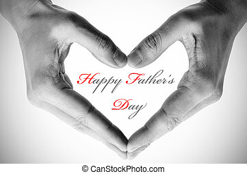 hands forming a heart and the sentence happy fathers day