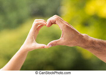 hands forming heart close up