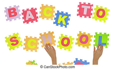 """Hands forming phrase """"Back to school"""" with jigsaw puzzle"""