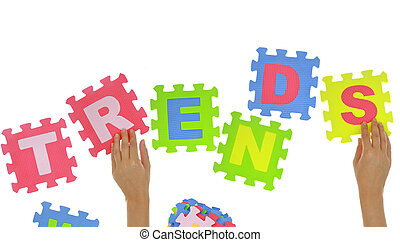 """Hands forming word """"Trends"""" with jigsaw puzzle pieces isolated"""