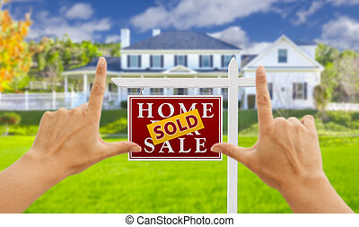 Hands Framing Sold For Sale Real Estate Sign and House