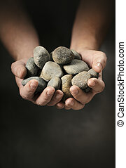 Hands full of rocks