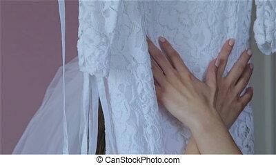 Hands girl in a wedding dress slip