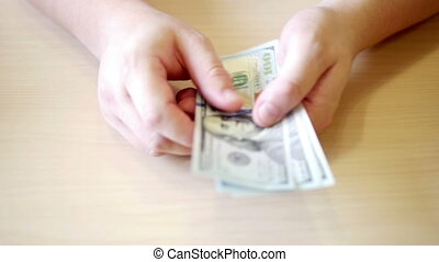 Hands giving and taking dollars on beige background