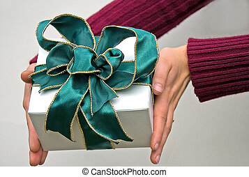 Hands Giving Gift With Green Bow