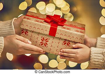 Hands giving x-mas gift - Merry Christmas and Happy...