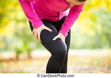 Hands grabbing a hip, sport injury