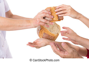 Hands grabbing for bread - Multiple hands grabbing for food