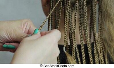 Hands hairdresser braid dreadlocks girl teen