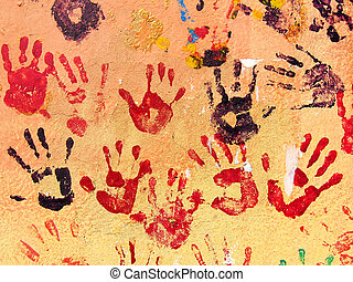 Hand prints painted on a wall