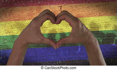 Hands Heart Symbol LGBT Pride - With a stylized rainbow flag...