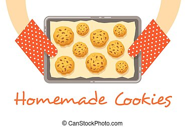 Hands hold a hot pan with fresh baked cookies - Homemade...