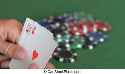 Hands hold and throw in royal flush of hearts - Man's hands...