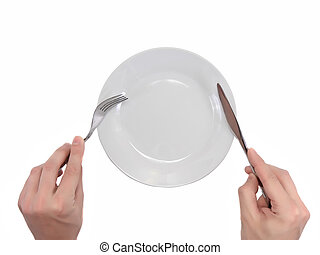Hands hold fork and knife above plate. - Hands hold fork and...