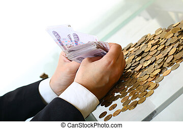 hands hold russian rouble money on white background