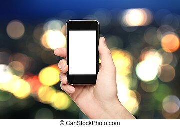 hands hold phone on blured background