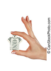 Hands holding a banknote in one dollar