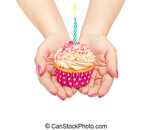 hands holding a birthday cupcake isolated on white background