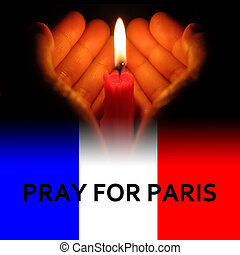 hands holding a burning candle in dark like a heart with pray for Paris on bottom