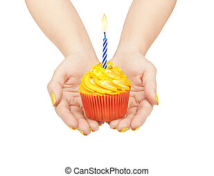 hands holding a cupcake isolated on white background