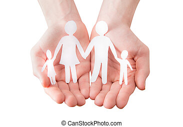 holding a paper cutout in the form of a family