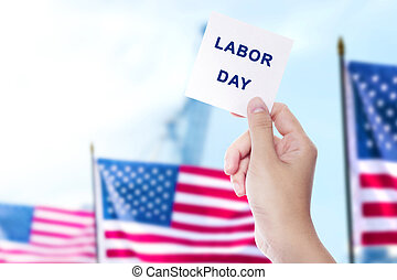 Hands holding a paper with Labor day message