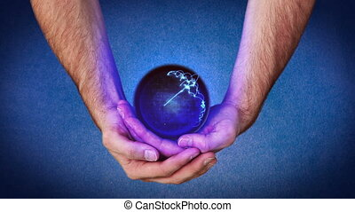 Hands holding a purple planet that