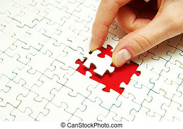 puzzle piece - hands holding a puzzle piece . business...