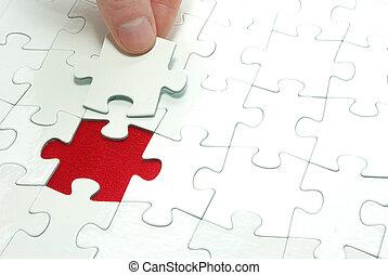 hands holding a puzzle piece . business concepts