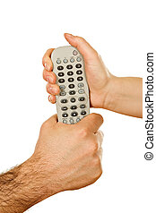 Hands holding a remote control