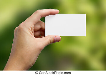 Hands holding a white business visit card, gift, ticket, pass, p