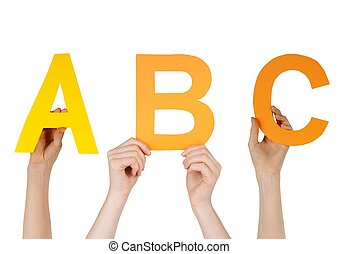 hands holding ABC - hands hold the letters ABC symbolizing...