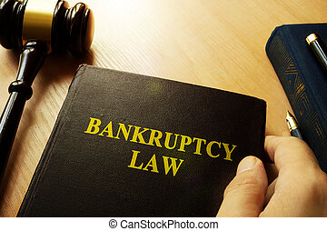 Hands holding Bankruptcy Law .