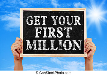 Get Your First Million - Hands holding blackboard with text ...
