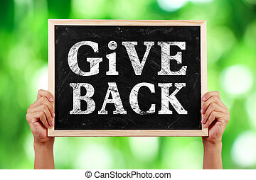 Give Back - Hands holding blackboard with text Give Back...