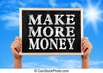 Make More Money - Hands holding blackboard with text Make...