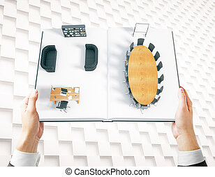 Hands holding book with interior