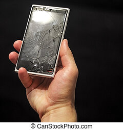 Hands holding broken mobile smartphone