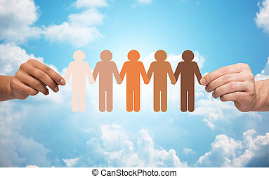 hands holding chain of people pictogram over sky