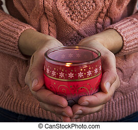 Hands Holding Christmas Scent Candle