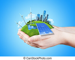 Hands holding clear green meadow with sun battery block,...