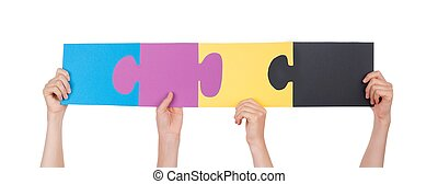 Hands Holding Colorful Pieces of a Puzzle