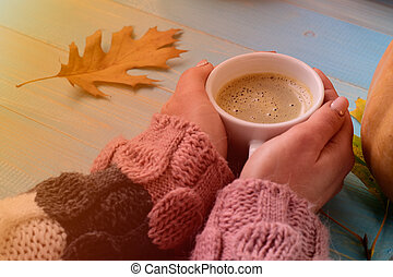 hands holding cup coffee