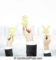 Hands holding currency signs