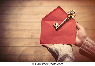 hands holding envelope and key
