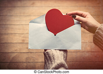 hands holding envelope and toy