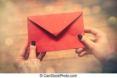 hands holding envelope